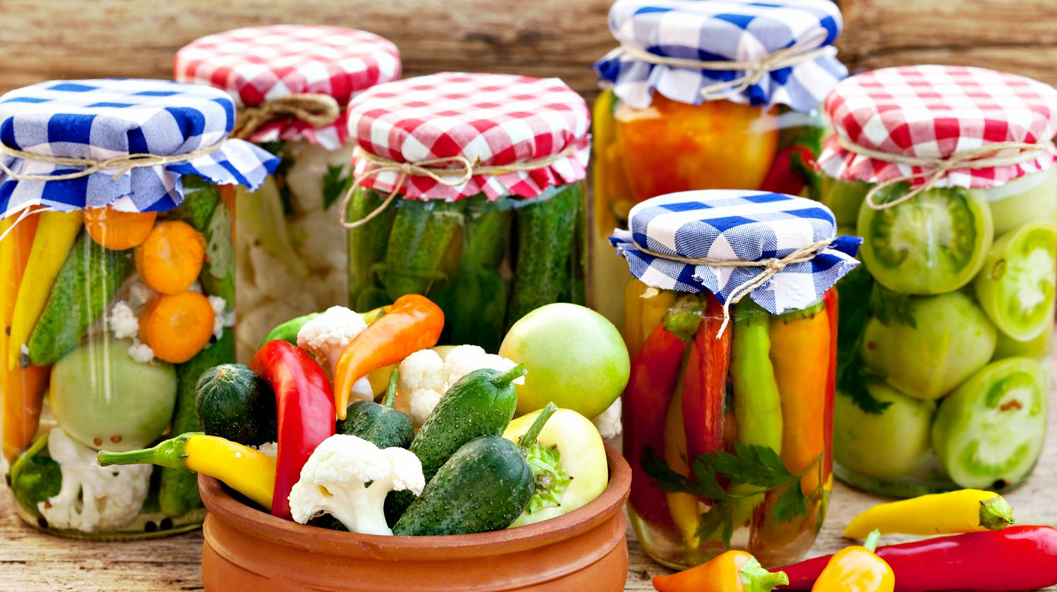 Jars with pickles, green tomatoes, cayenne pepper, mixed salad and chillies   Canning Tips To Make Food Last For A Long Time   Featured