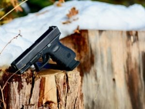 Glock 19 product shot outdoor autumn snow | Glock 19 For Concealed Carry Review | Featured