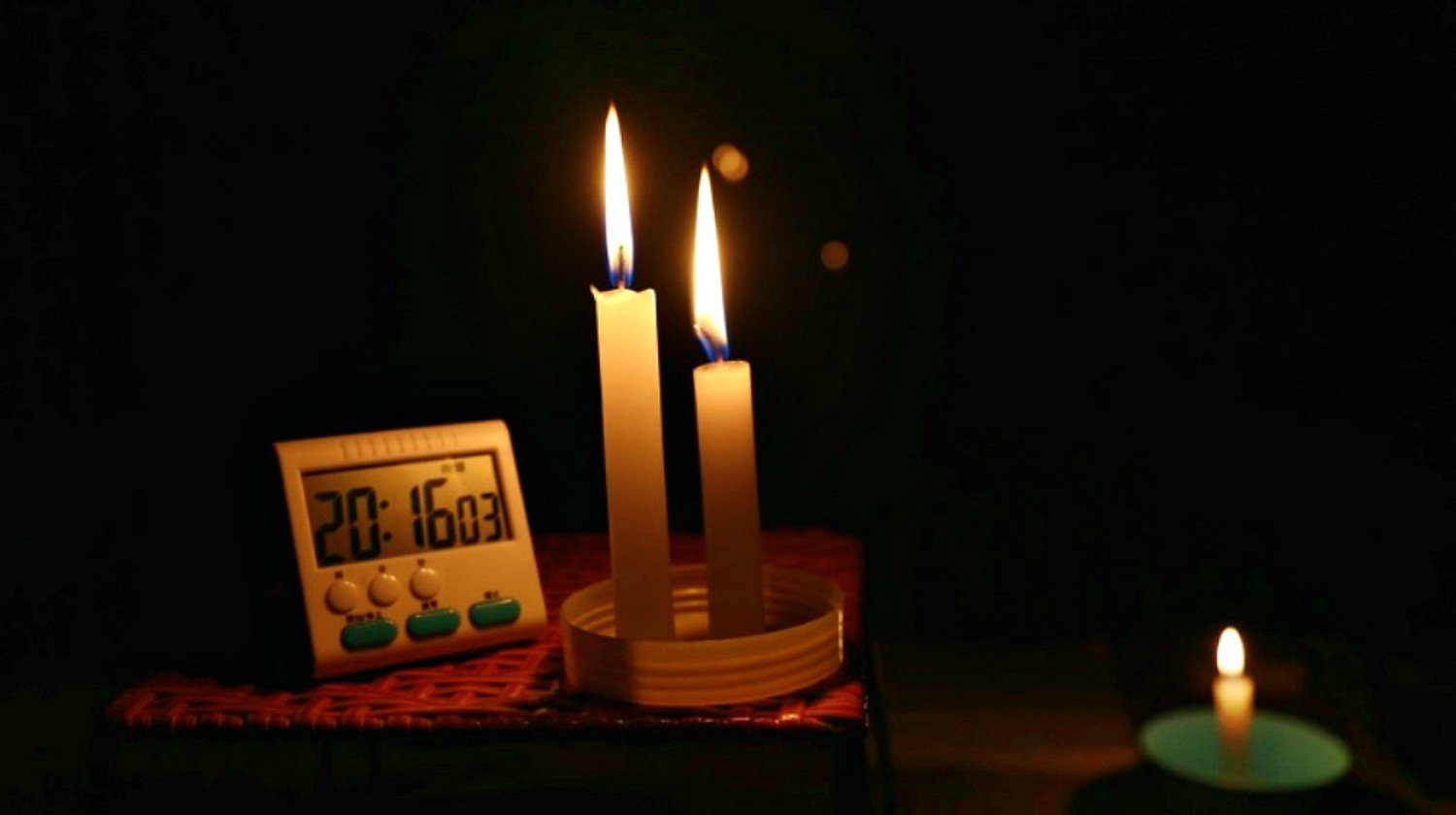 Feature | Burning Candle beside clock in the table | Power Outage: What To Do When The Power Goes Out
