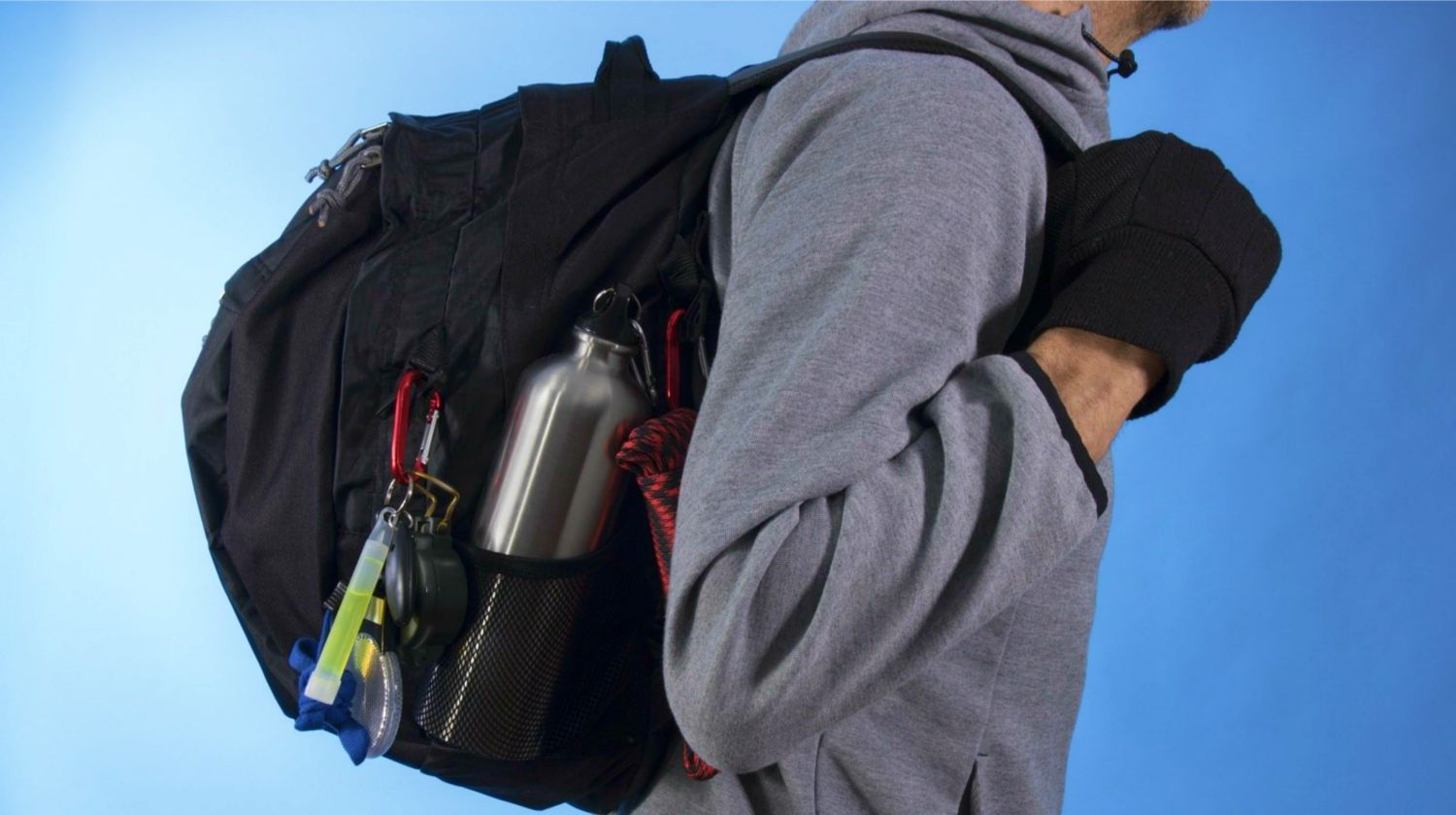 Feature | Man with bug out bag on blue background | How To Argue With Non-Preppers