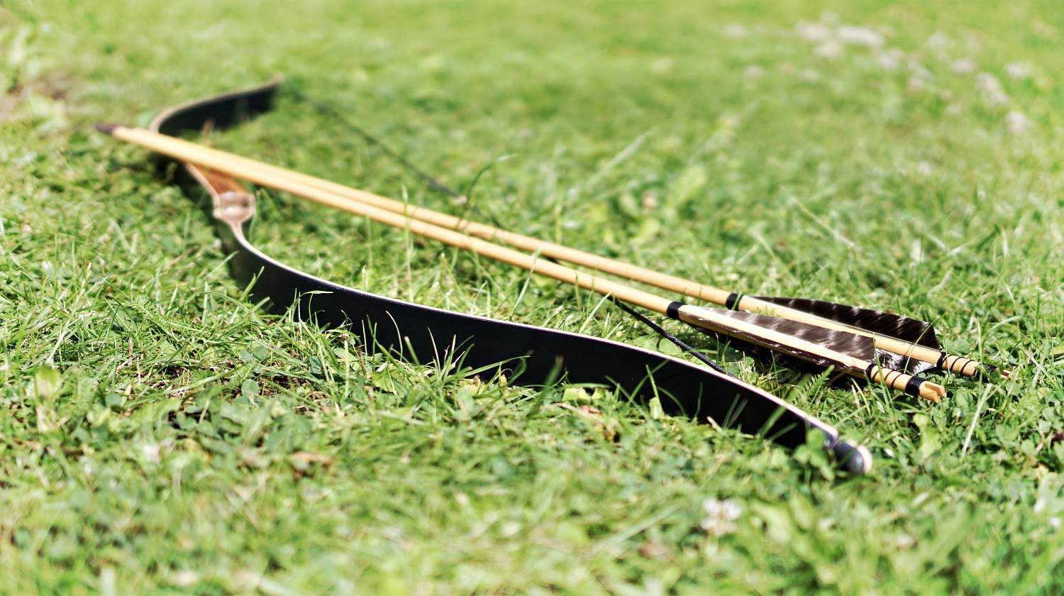 Featured | Black and brown bow on grass field during daytime | How To Build A DIY Longbow [Video]
