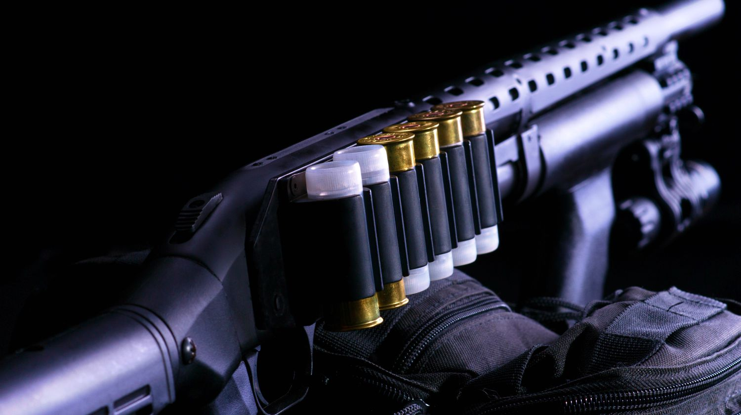 Shotgun, shotgun cartridges on a black background | The Best In Home Defense | Mossberg 500 Tactical | Featured