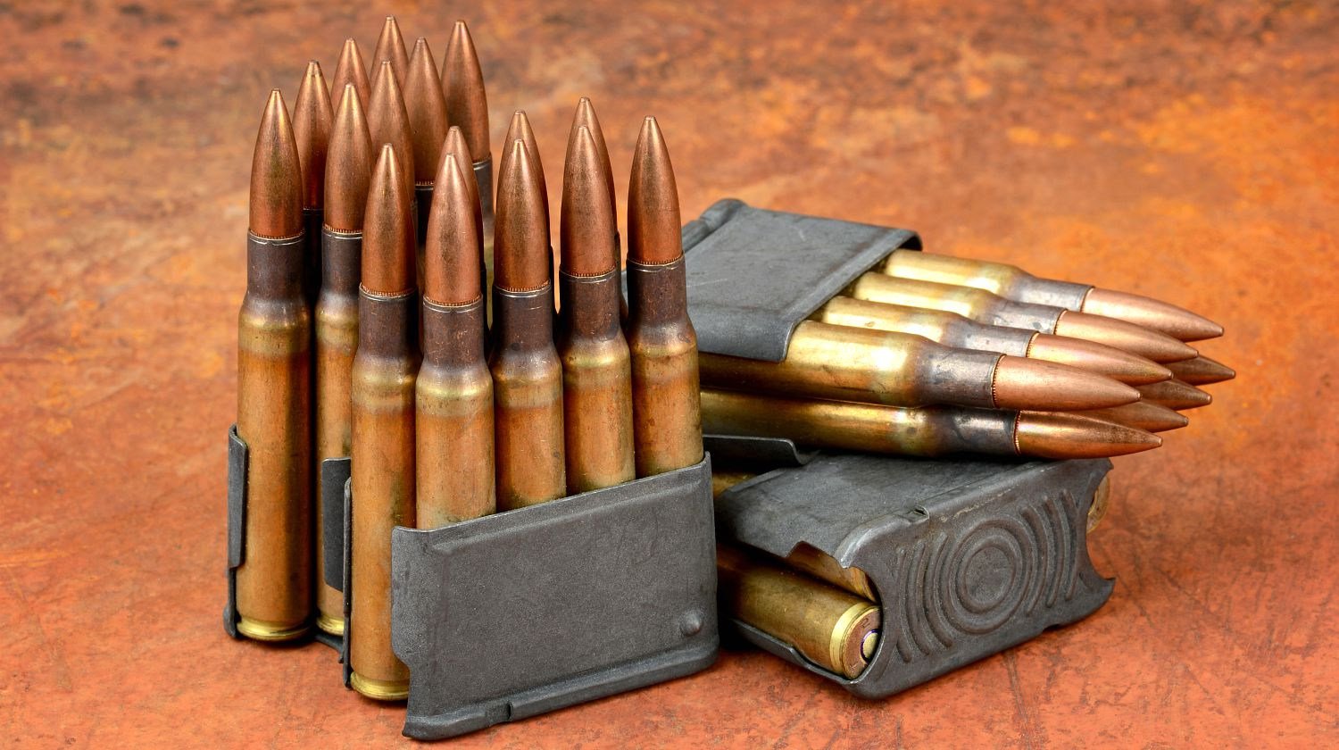 World war II M1 clips and 30-06 ammunition on rusty background | Modern Shooter: .30-06 Springfield | Featured