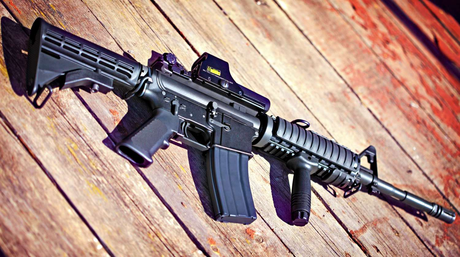 Feature | Rifle on a wooden surface | Gun Modifications | AR-15 Dos and Don'ts