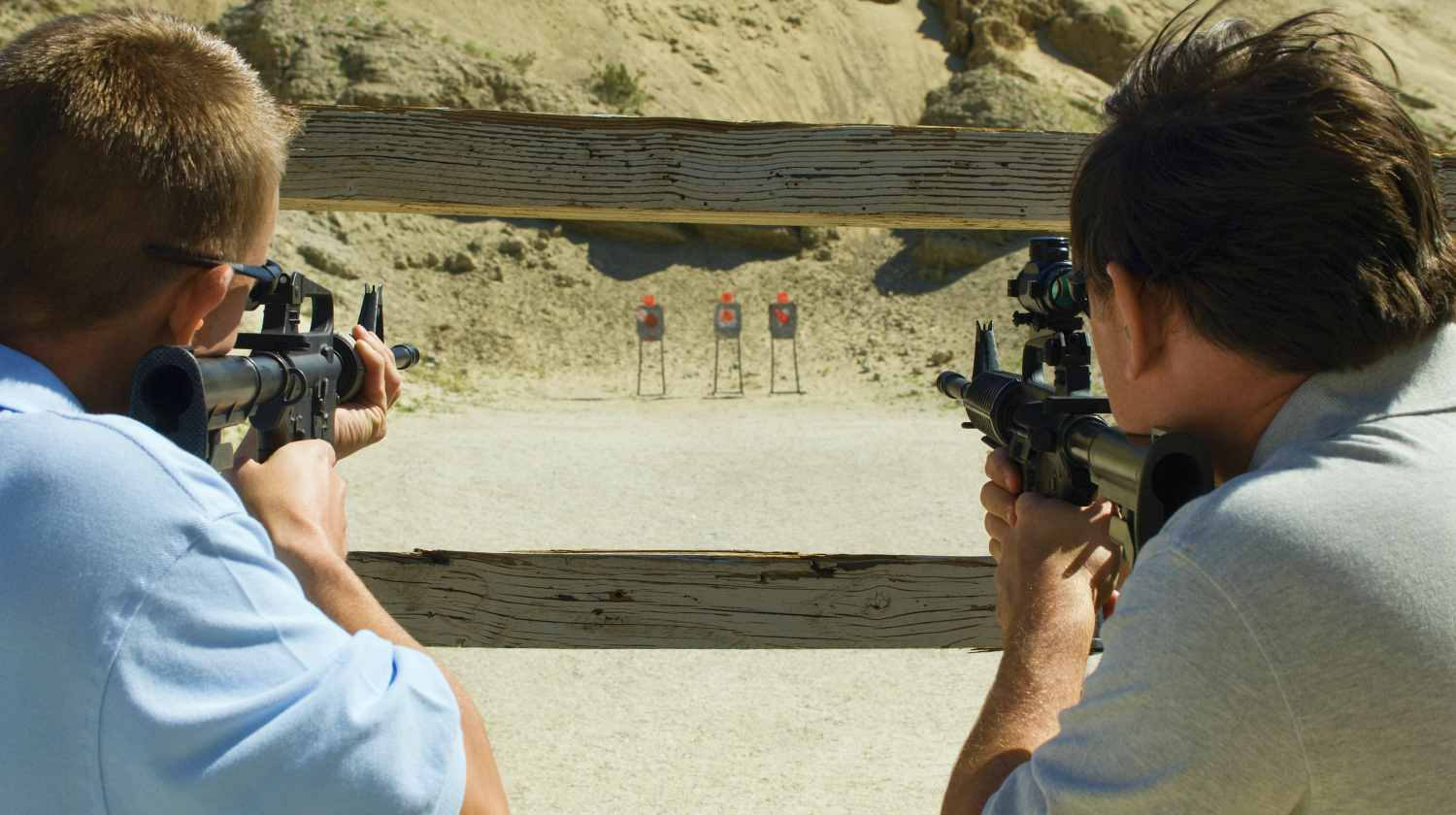 Feature | Men aiming rifles at firing range | Rifle Shooting Tips & Techniques | Surprising Things New Rifle Shooters Need to Know