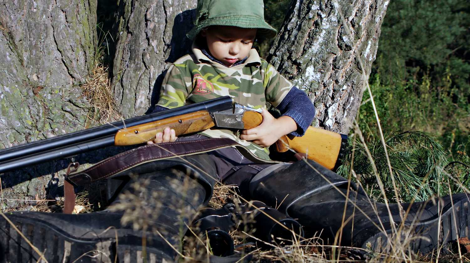 Feature | Boy hunting with gun | Your Child's First Firearm | Options For Your Kids