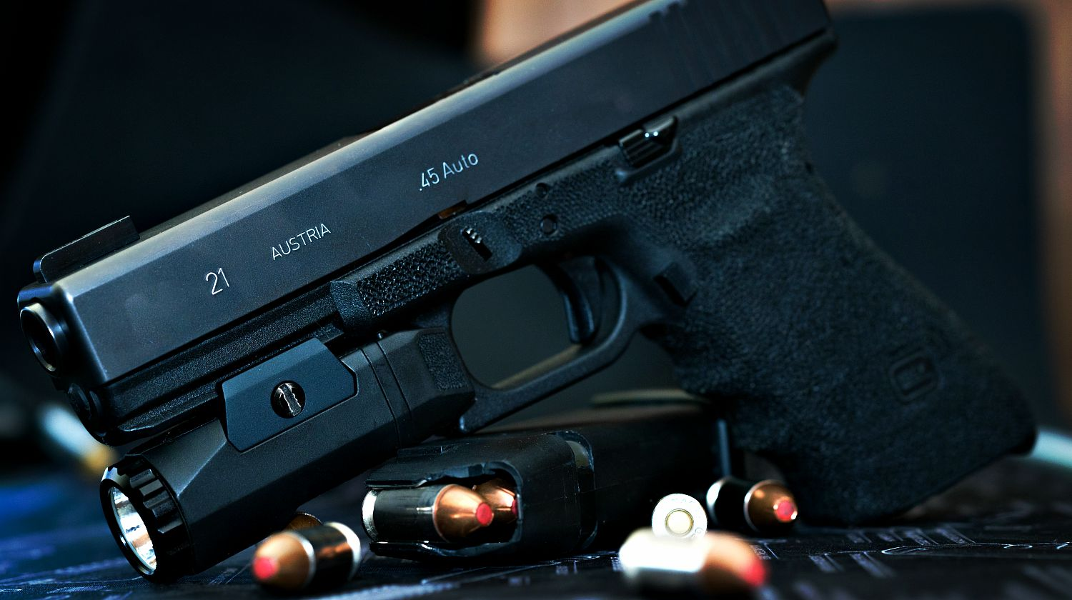 Feature   Glock 21 handgun with flash light and hollow point bullets   Mastering The Glock Trigger