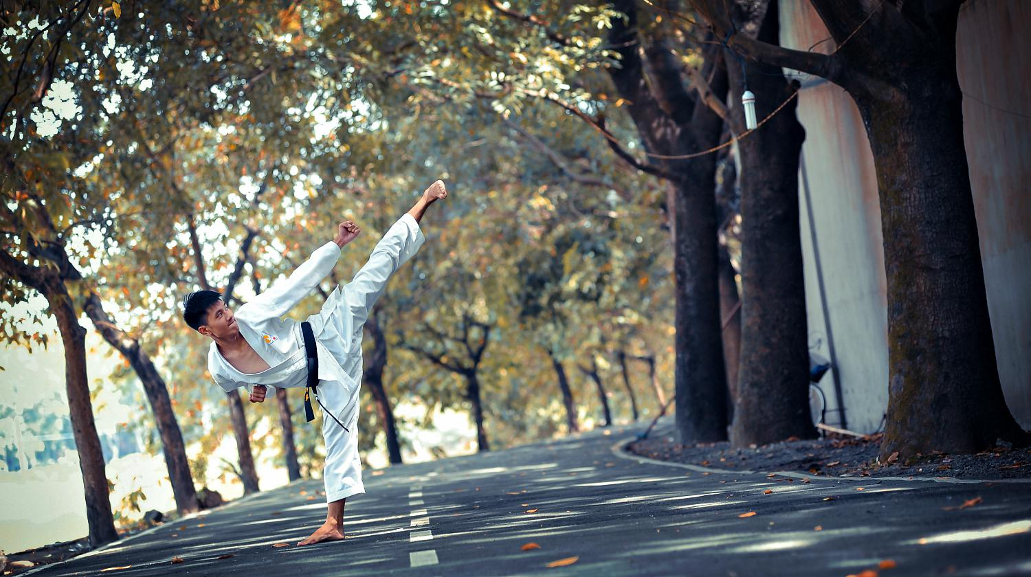 Featured | A man doing standing on road | Self-Defense Martial Arts For Personal Safety And Survival