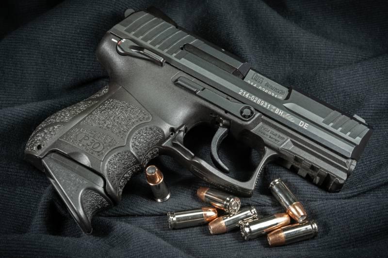 Heckler & Koch P30 SK 9mm semi-auto handgun with loose 9mm hollow point cartridges 9mm Handguns for Women SS