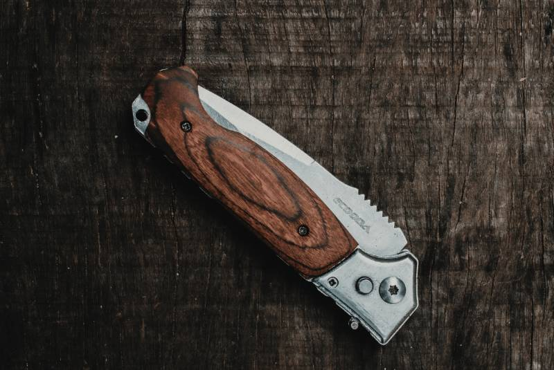 brown and silver folding knife | Arkansas Knife Laws