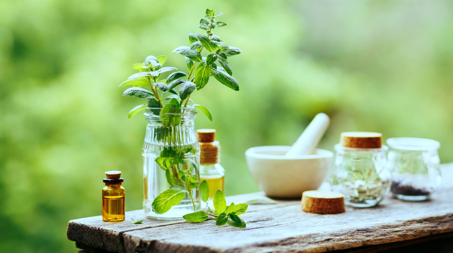 Feature | Essential Oil Peppermint Bottle on wooden table | Survival Uses For Peppermint Oil