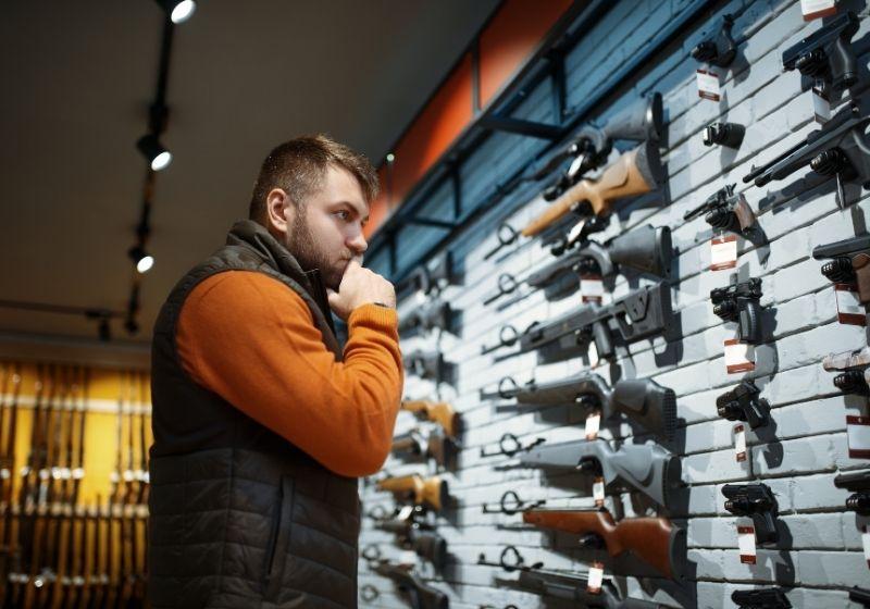 Man looking on handguns Best caliber for self defense SS