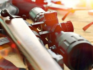 Feature | Close up of rifle telescope for sport hunting on table wooden | Types Of Guns That Will Keep You Alive On Doomsday