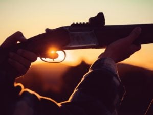 rifle hunter silhouetted beautiful sunset powerful | Finding Your Norinco SKS Production Date | featured