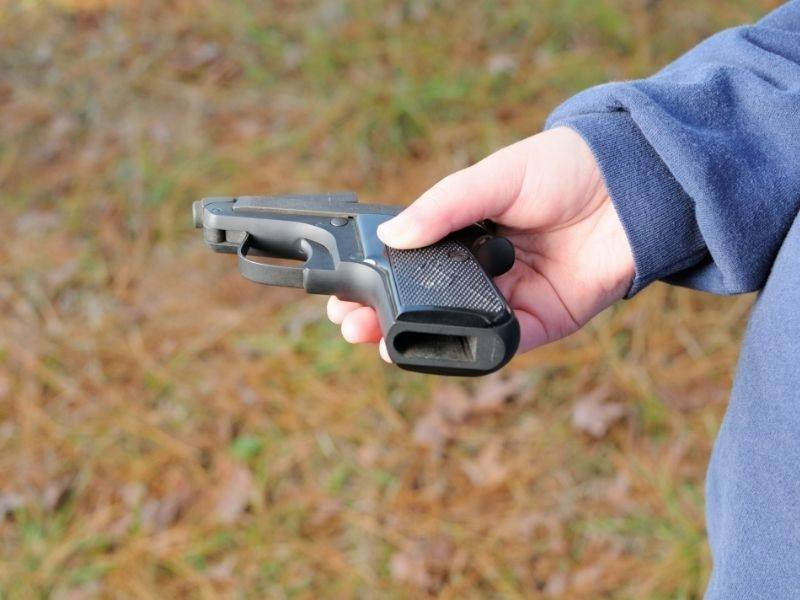small-handing-holding-small-pocket-pistol | beretta 21a bobcat reliability