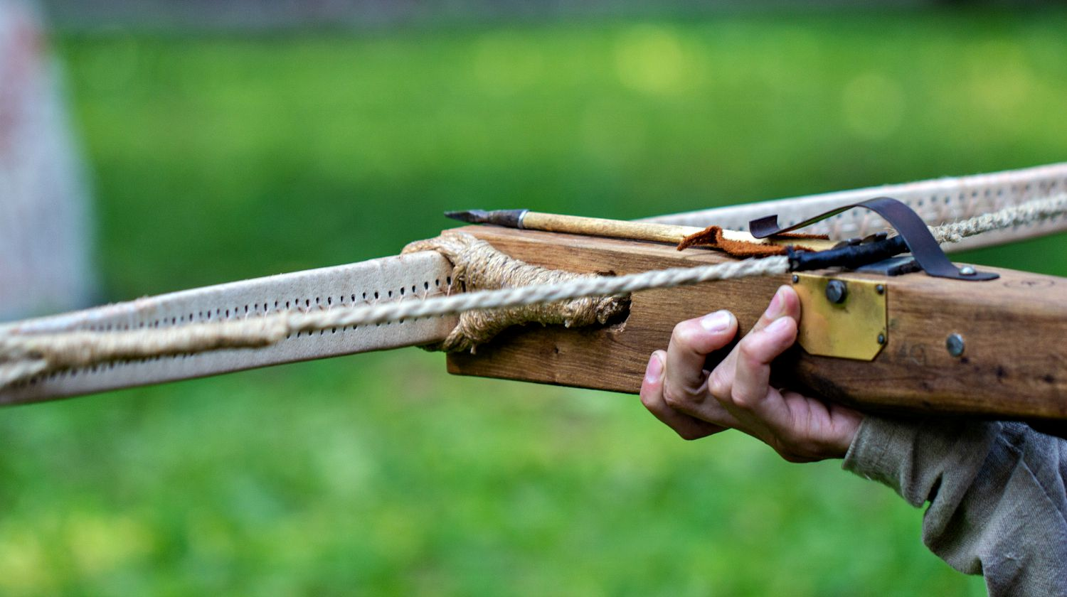 A man with crossbow in the woods | DIY Survival: How To Make A Crossbow From Scratch [Video] | Featured