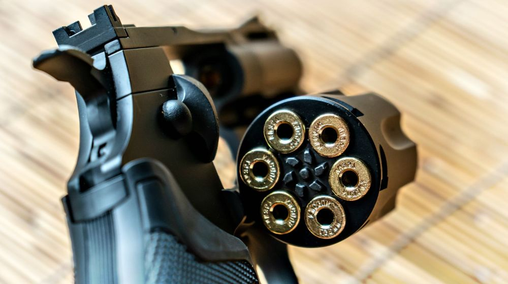 ammunition-packed-into-black-pisto | modern-revolvers | Feature