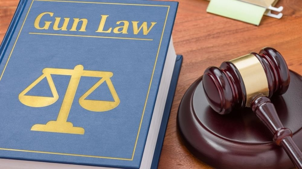 A law book with a gavel | How To Travel Interstate With Your Firearm | Featured