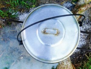 Featured | Cooking rice using cast-iron cauldron pot in outdoor | Make A Survival Cooking Kit From A Zebra Pot