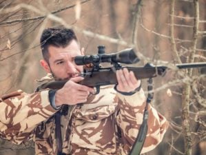 man-holding-sniper-shooting-on-open long range | Finally: Best Budget -Friendly Long Range Hunting Rifles | Featured