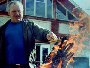 Feature   Man in blue crew-neck shirt and black leather jacket holding wooden stick   Fire Starting Materials You Probably Have At Home