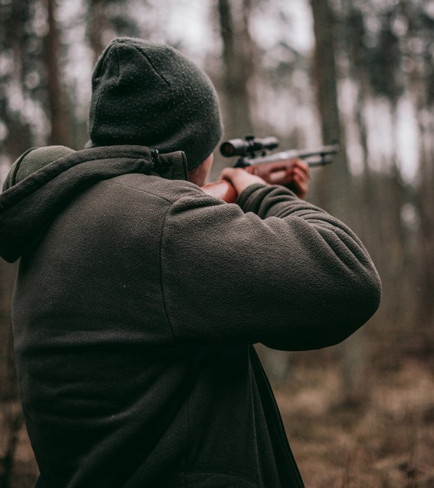 Man Using his Rifle for Hunting   Tips to Improve Your Marksmanship