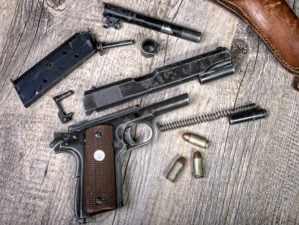 Disassembled Handgun | The Difference Between Striker-Fired And Hammer-Fired