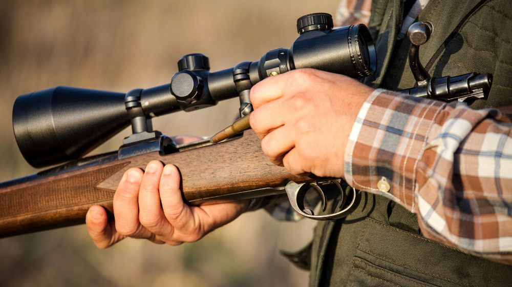 hunter holding rifle   Marlin 336 Review: Is This A Worthy Add To Your Collection?   featured