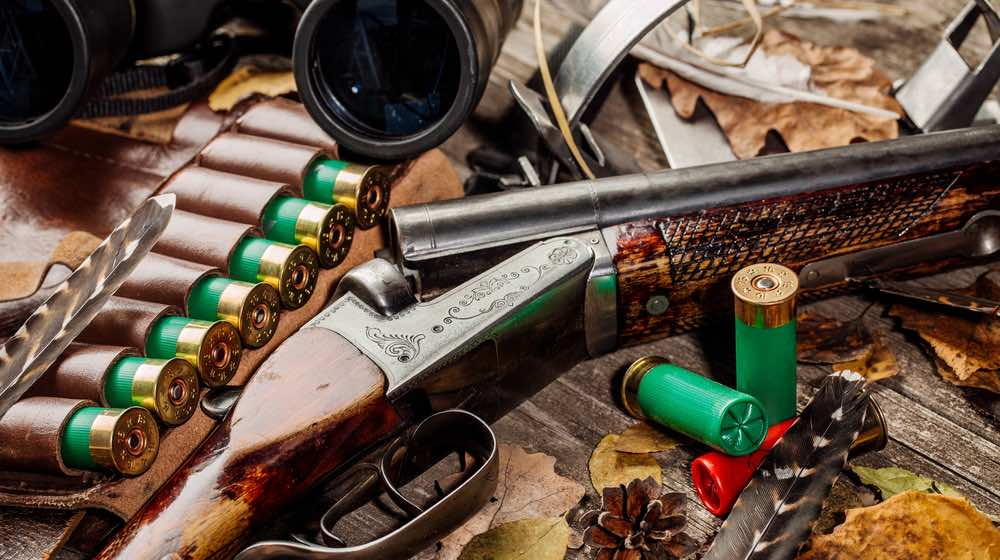 Hunting equipment on the wooden background. Hunt concept. | Coyote Hunting Gear | Featured - ss