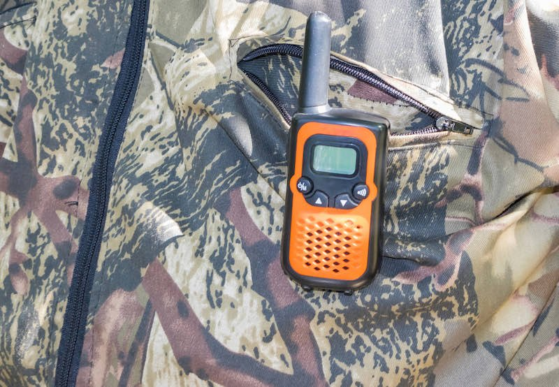 Portable civilian radio stations in the hands of man and on clothes | deer lease checklist