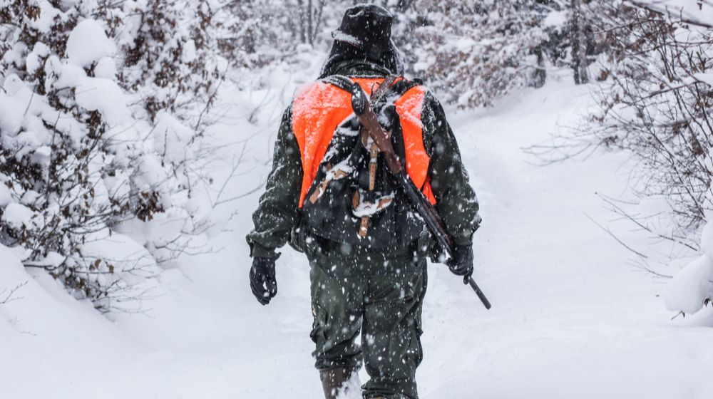 hunter-camouflage-shotgun-on-winter-hunting | Coyote Hunting in Colorado | It's a Game! | Featured