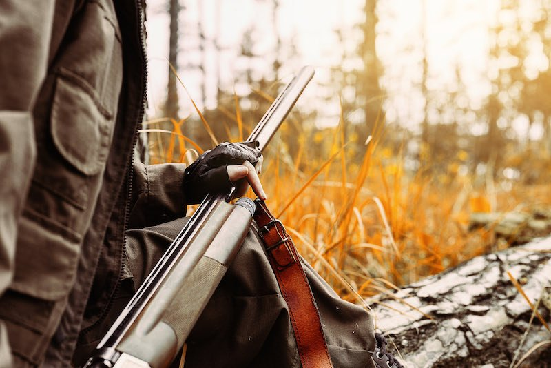 Autumn hunting season. Woman hunter with a gun | elk hunting checklist
