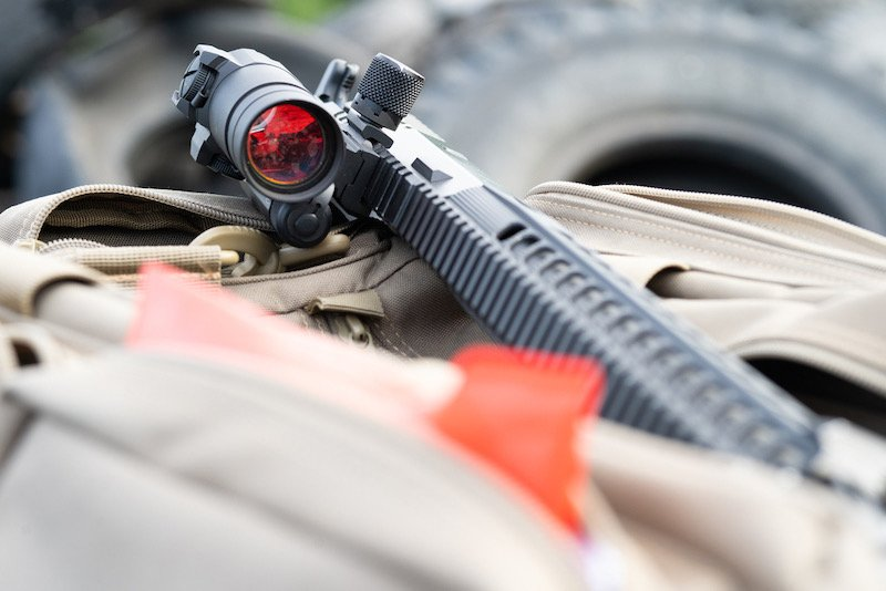 The modern AR15 rifle with an eye is on the weapons black bag | survival rifle multi caliber