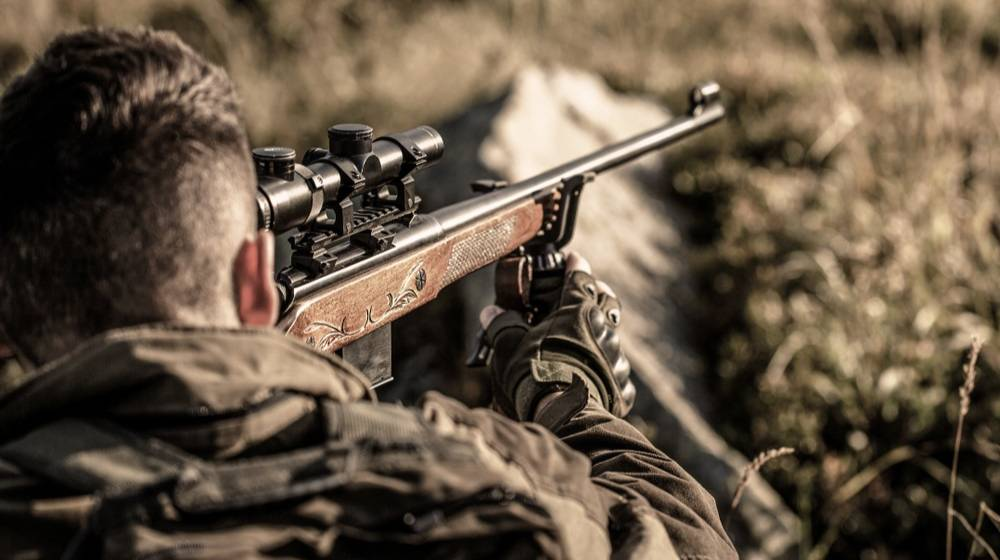 man-on-hunt-hunting-rifle-hunter | Coyote Hunting Tips You Need To Know! | Featured
