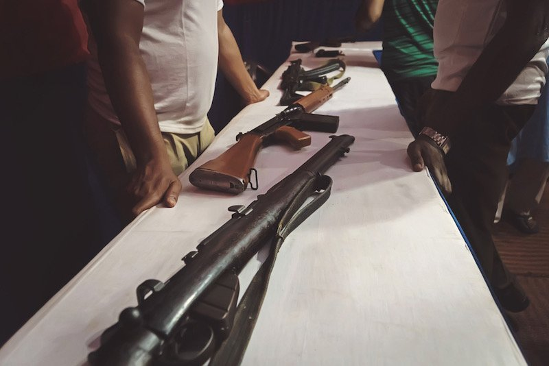 Arms trafficking. different rifles on the counter in the gun shop | folding survival rifles