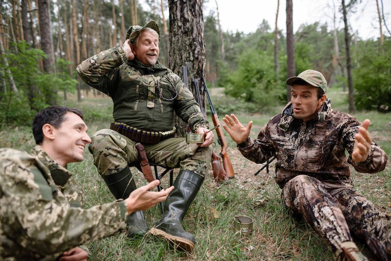 Hunters sit in the forest and talk about a great hunt | running and gunning turkey hunting