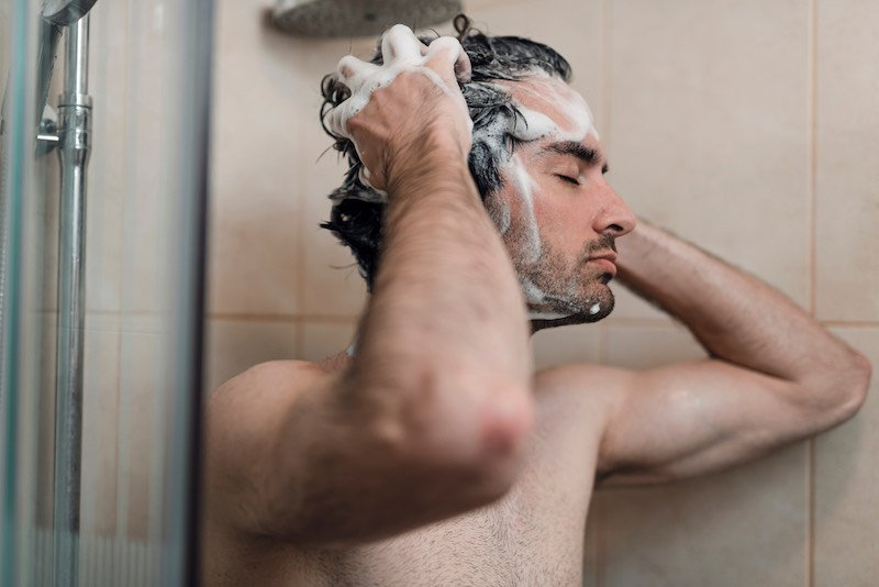 Young single handsome caucasian man are taking shower in the bathroom | rabbit hunting with beagles