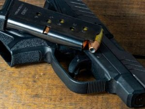 .380 caliber semi-automatic handgun and magazine loaded with hollow point ammunition | The Top 380 ACP Handguns | Featured