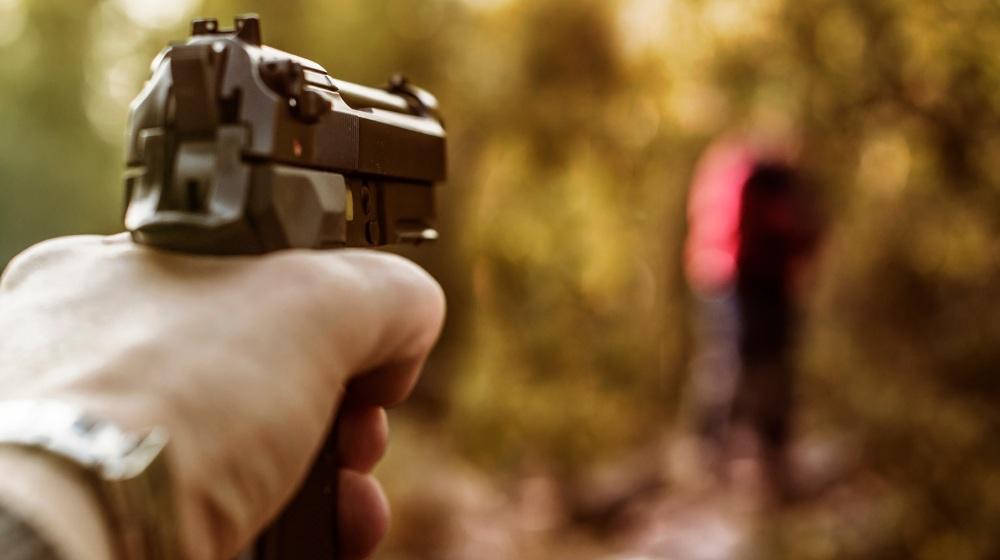 Shooter with Beretta M9 black gun-Beretta M9-SS-Featured