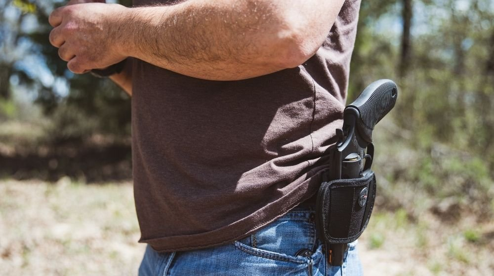 Close up side view of a man wearing an open   Top 5 Carry Guns Under $300   Featured