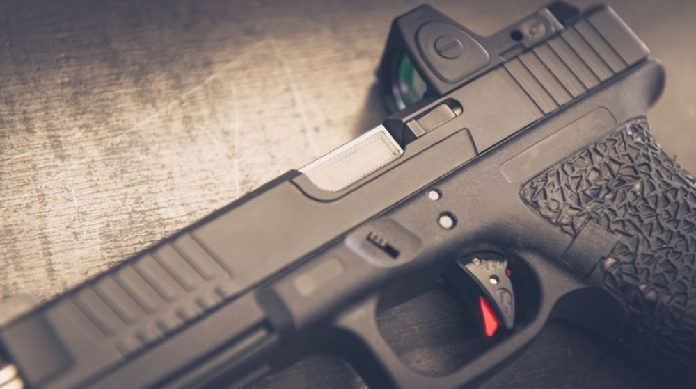 Custom Handgun laying on on table close up | Are Pistol Sights Actually Useful For Self Defense? | Featured