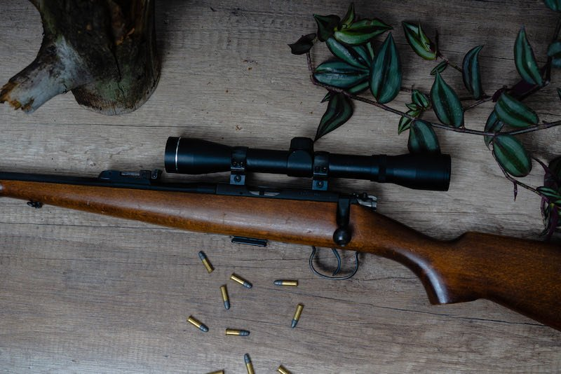 Top view of beautiful rifle with wood stock | long range shooting tips