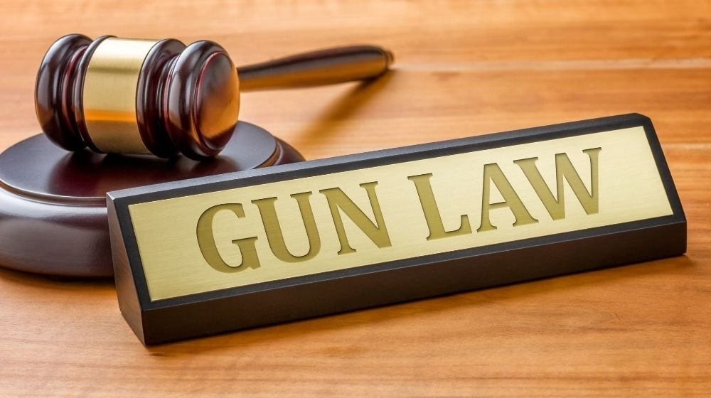 A gavel and a name plate with the engraving Gun Law   Missouri's Second Amendment Sanctuary Law is Being Challenged   Featured