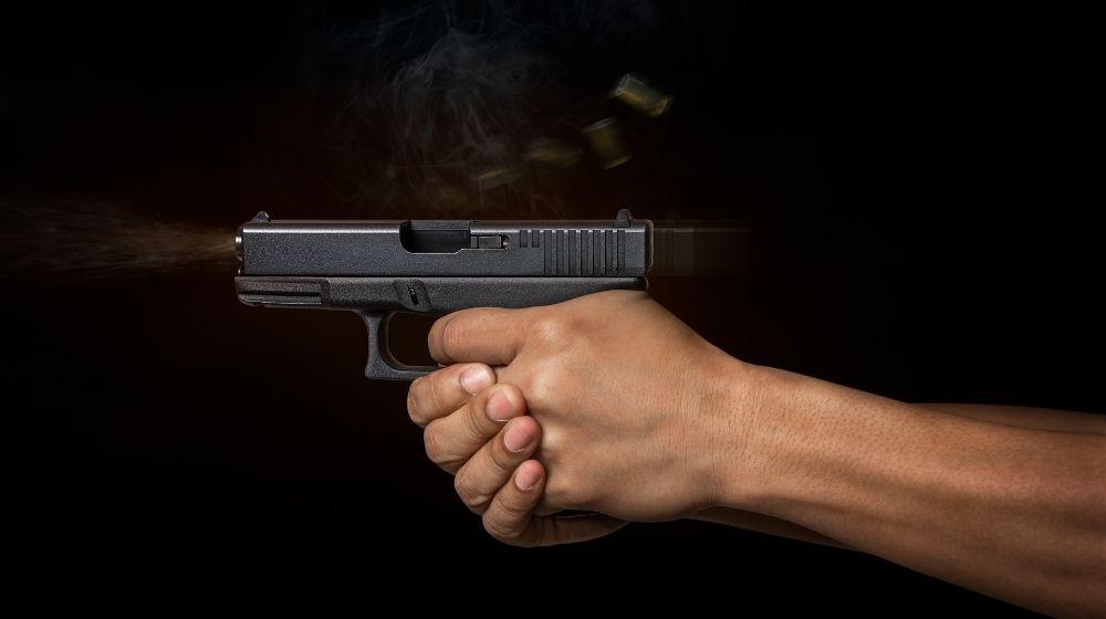 Man hand holding on the automatic pistol gun Cellphone gun | Have you seen the Cellphone Gun? | Featured