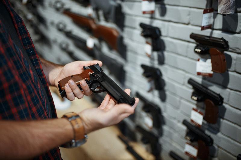 Man holds handgun in gun shop | sig sauer m18