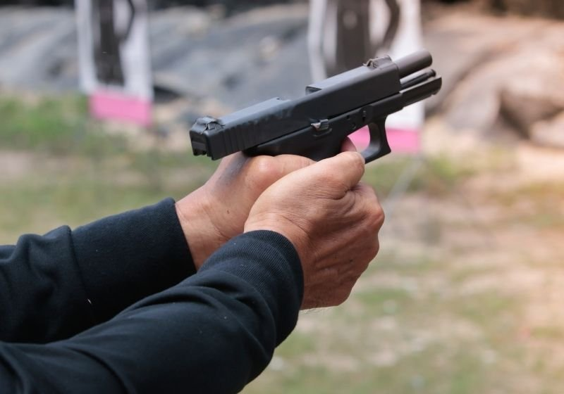 The action of recoiling man reloading pistol gun Springfield XD M SS