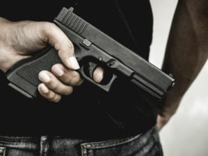 A man holding a gun in hand | Top 5 Most Accurate 9mm Pistols In The World | Featured