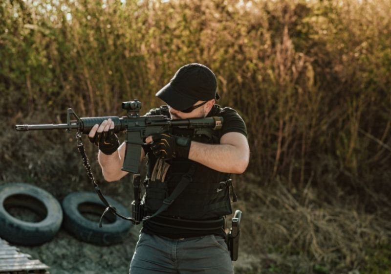 Armed guy shooting with rifle How to aim a rifle SS