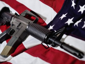 Flag of the USA with rifle | Top 10 Best Ar-15 Pistols In The World 2021 | featured
