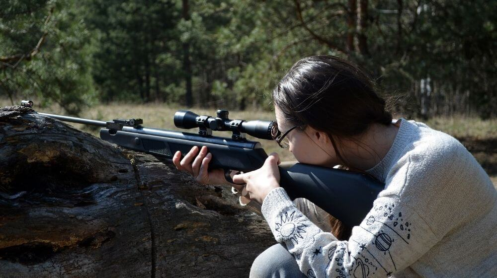 Girl with gun in the forest Tikka rifles   Top 5 Best Tikka Rifles For Hunting 2021   Featured